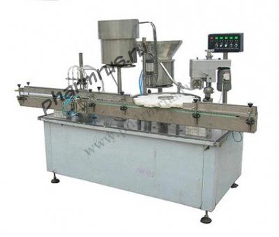 Автомат для розлива, укупоривания и запечатывания тары